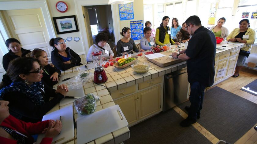 Miguel Valdez, executive chef from Red Door and Wellington Steak & Martini Lounge in San Diego, teaches a class as part of the Cooking for Salud seven-week bilingual course at Olivewood Gardens and Learning Center in National City in March 2016.