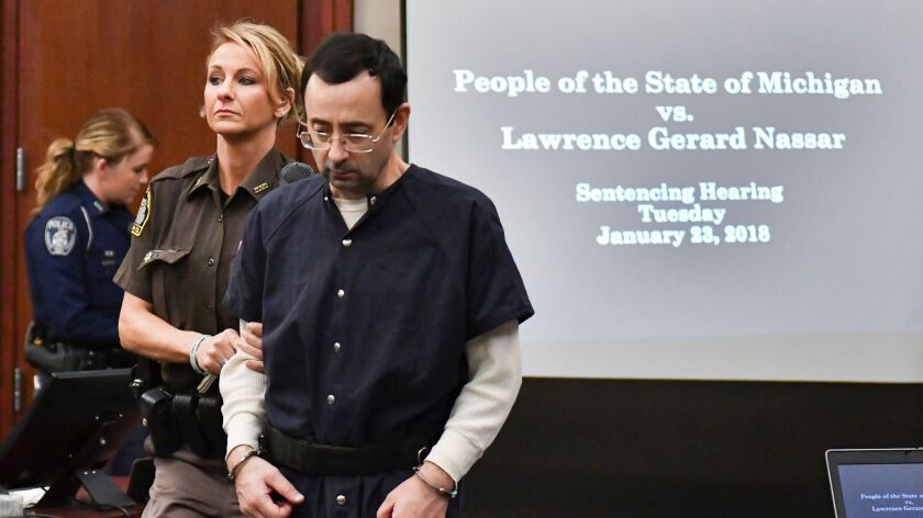 Larry Nassar is brought into court Tuesday, Jan. 23, 2018, in Lansing, Mich. Nassar, 54, has admitt