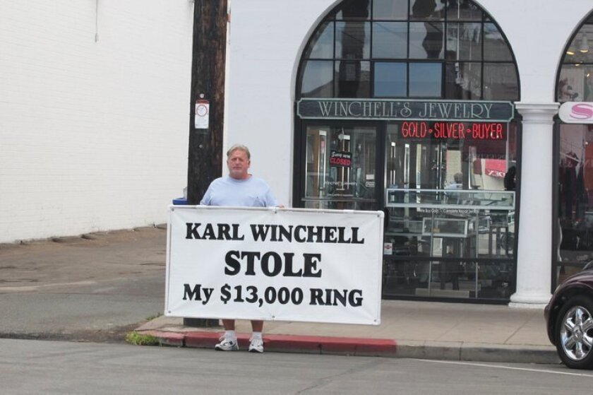 James Hall stood in front of Winchell Jewelry Designs on Wall Street for nearly two weeks in November 2013 to call attention to his dispute with the store owner.