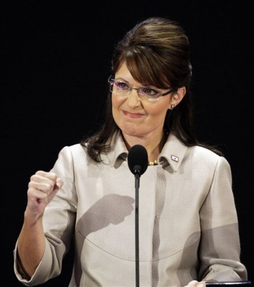 FILE - In this Sept. 3, 2008 file photo, Republican vice presidential candidate, Alaska Gov. Sarah Palin, pumps her fist during her speech at the Republican National Convention in St. Paul, Minn. Records show that Sarah Palin hasn't paid any property taxes on cabins that have been built on two backcountry plots partially owned by the former Alaska governor. There are no tax assessments for the two-story, house-sized cabins, a workshop and a sauna spotted Thursday Feb. 4, 2010, in an aerial survey. Property taxes totaling $156.13 were paid on the land in 2009 _ but that bill did not include anything for the structures because the local assessor didn't know about the new construction nearly 100 miles north of Anchorage. (AP Photo/Ron Edmonds, file)