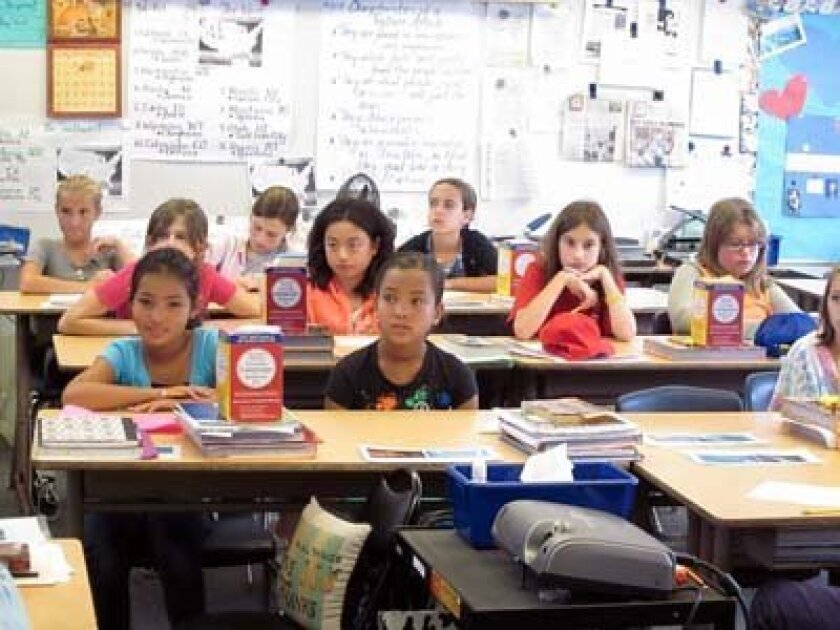 Students absorb tips on writing. Photo: Ginny LaRowe