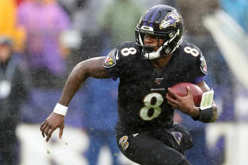 Ravens quarterback Lamar Jackson looks for running room.