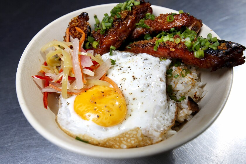 The Pinoy BBQ at Sari Sari Store in Grand Central Market features garlic pork ribs, garlic rice, apsara and fried egg.