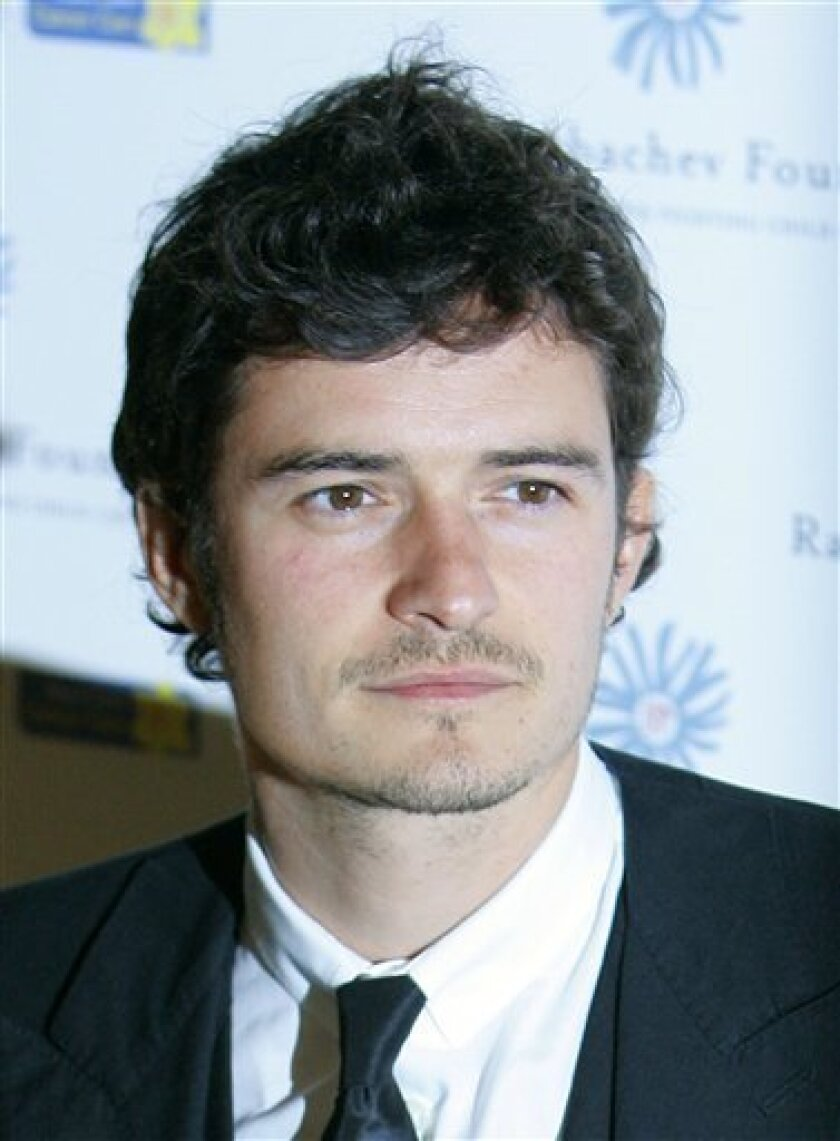 FILE - In this June 7, 2008 file photo, actor Orlando Bloom arrives at the Raisa Gorbachev Foundation Gala dinner in Hampton, in Surrey, England. (AP Photo/Kirsty Wigglesworth, file)