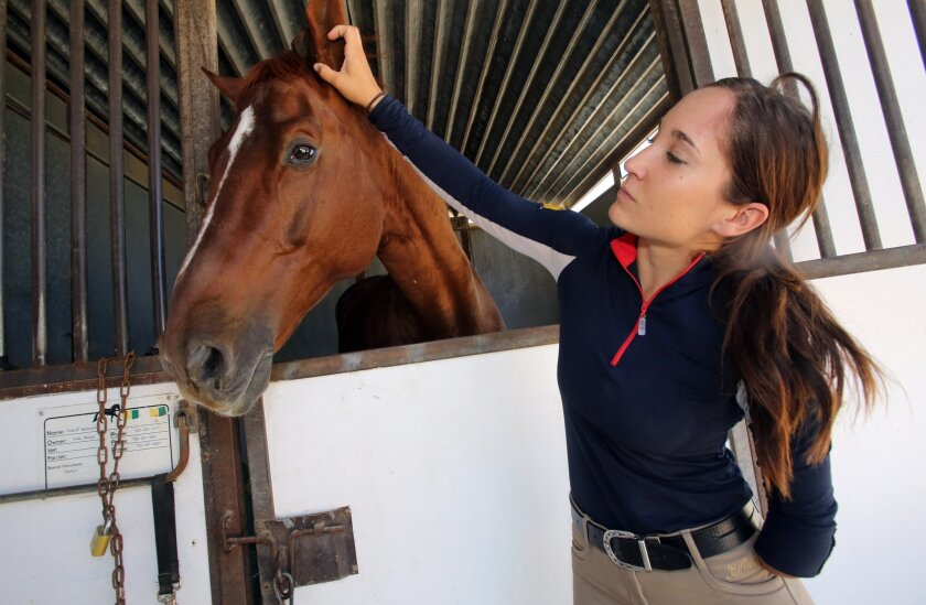 Holly Bergay seen with her horse Rubino Bellisimo in mid-May in Rancho Santa Fe, before they traveled together to the para-dressage national championships in New Jersey. The horse was diagnosed with cancer on the East Coast and was euthanized just days after the competition.