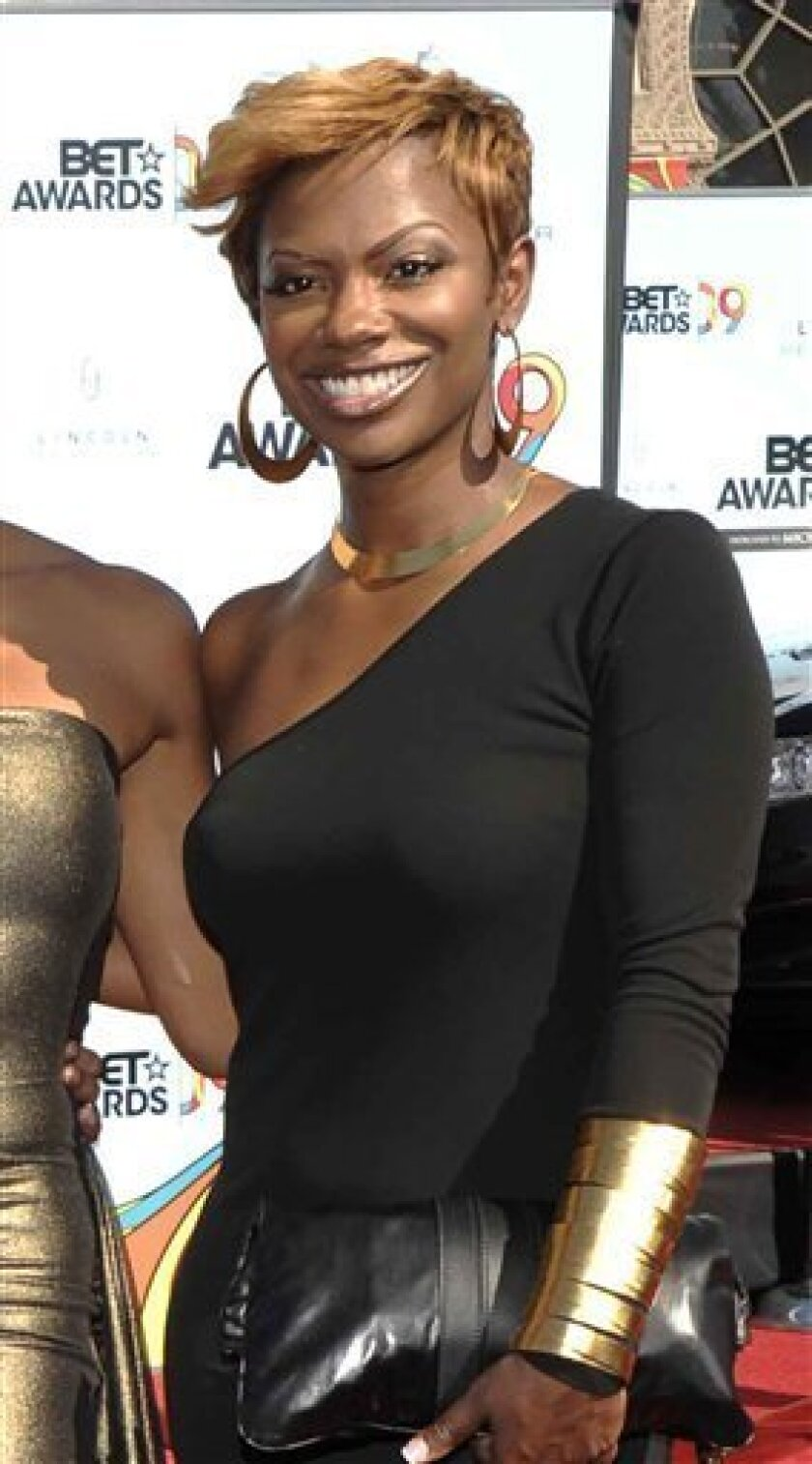 """FILE - In this June 28, 2009 file photo, Kandi Burruss poses as she arrives at the 9th Annual BET Awards in Los Angeles. The former fiance of the cast member from """"The Real Housewives of Atlanta"""" died Friday, Oct. 2, 2009 after a fight outside an Atlanta strip club, and police said they had charged a man in his death. Atlanta police spokesman James Polite said Fredrick Richardson was charged with voluntary manslaughter in the death of Ashley """"A.J."""" Jewell, who died from massive head injuries after the fight in the parking lot of the Body Tap Club. Jewell was engaged to """"Housewives"""" cast member Kandi Burruss until August. (AP Photo/Dan Steinberg, File)"""