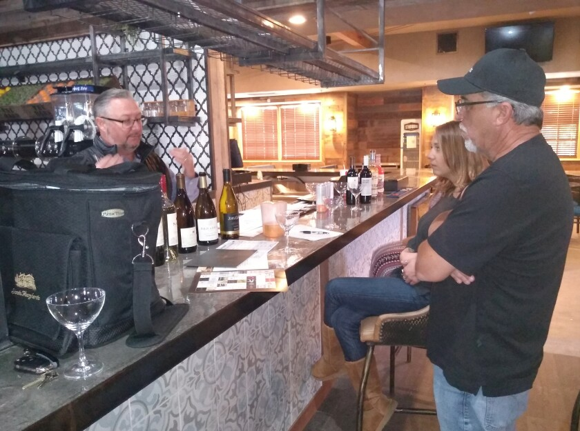 Michael Kelly of Trinchero Winery, left, pours wine samples he supplies to Young's Market for Barn restaurateur Vito Tutino.