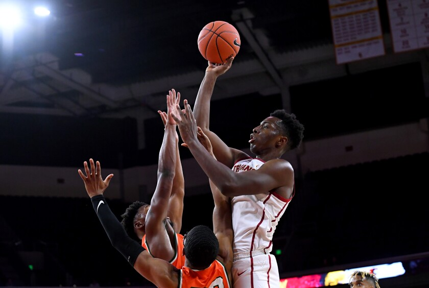 USC's Onyeka Okongwu shoots over Florida A&M's Bryce Moragne and Brandon Myles.