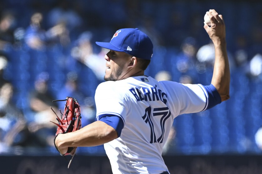 Toronto Blue Jays starting pitcher Jose Berrios pitches in the first inning of a baseball game against the Minnesota Twins in Toronto on Sunday, Sept. 19, 2021. (Jon Blacker/The Canadian Press via AP)