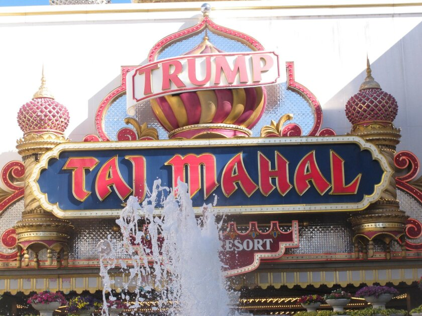 In this photo taken June 30, 2016, the exterior of the Trump Taj Mahal casino in Atlantic City, N.J. Donald Trump has promoted his casinos as historically successful and profitable, done in only by the economic decline of Atlantic City. (AP Photo/Wayne Parry)