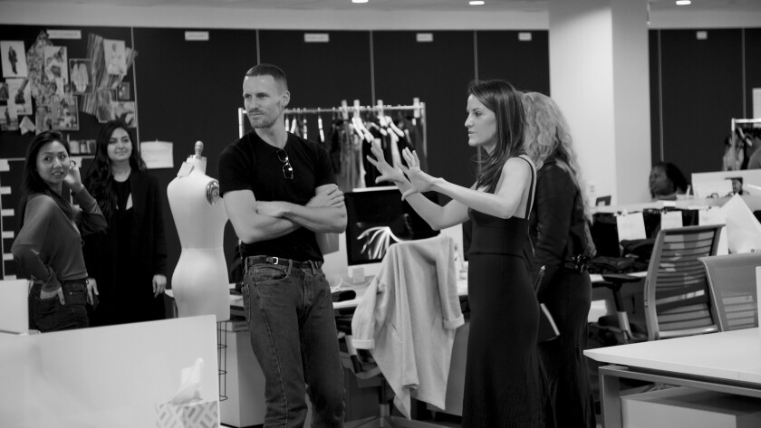 Designer Dion Lee, left, and Carbon38 founder and Chief Executive Officer Katie Warner Johnson during a fitting.