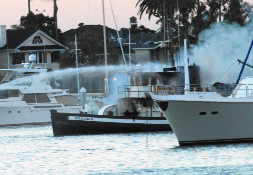 The William B, a 76-foot wooden tugboat built in 1942, was destroyed by fire Saturday morning in Newport Harbor.