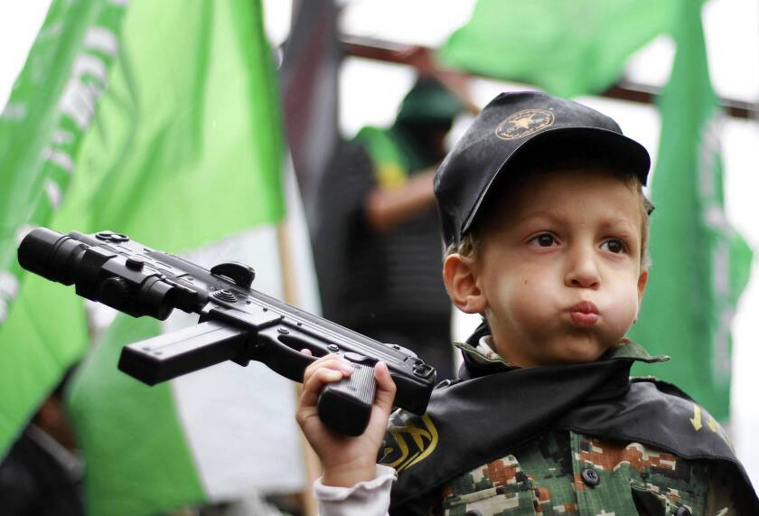 A young Palestinian joins a Hamas rally in Hebron, a town in the West Bank, which is ruled by Hamas' rival, Fatah.