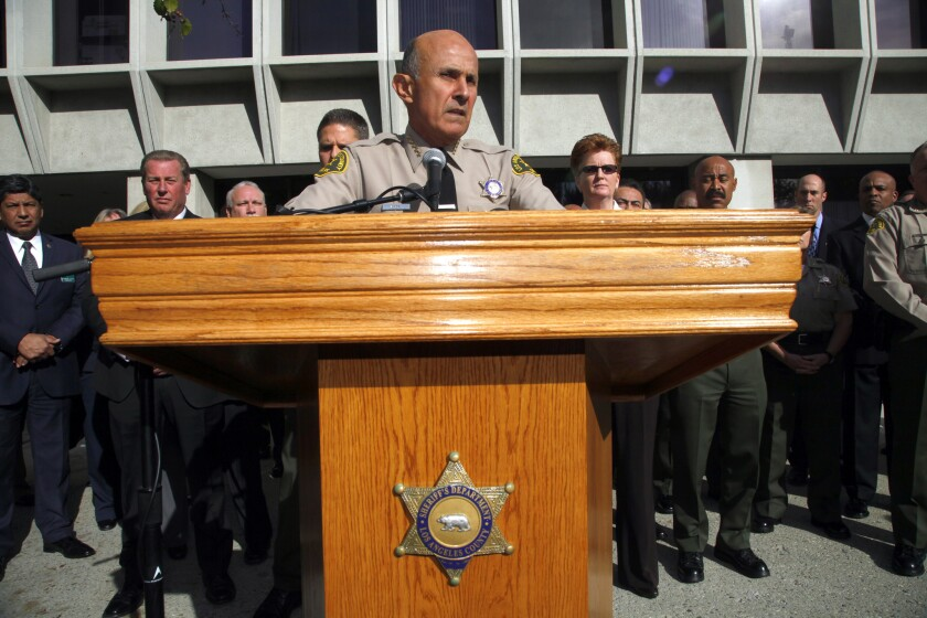 With his command staff standing behind him, Los Angeles County Sheriff Lee Baca announces he will not seek a fifth term.