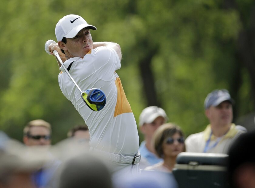 Rory McIlroy, of Northern Ireland, watches his tee shot on the 15th during the first round of the Memorial golf tournament, Thursday, June 2, 2016, in Dublin, Ohio. (AP Photo/Darron Cummings)