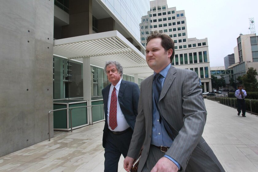 Todd Bosnich, right, and his attorney Frank Vecchione, left, walked in to the Federal Courthouse Friday for processing after Bosnich pleaded guilty to obstruction of justice.