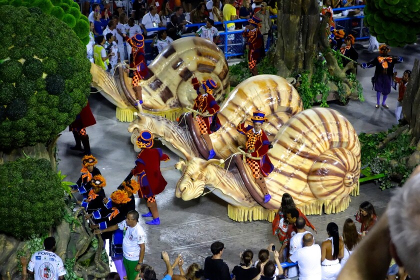 Mega-snails make their way along the Carnival parade route in Rio.