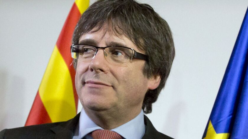FILE - In this Dec. 21, 2017 file photo ousted Catalan leader Carles Puigdemont takes the podium at