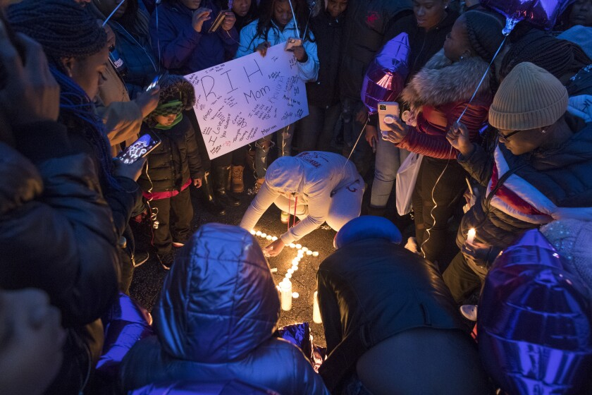 Friends and family of Annie Sandifer hold a vigil for the pregnant woman who died following a drive-by shooting Saturday, February 1, 2020 in the 4300 block of N. 60th St. in Milwaukee, Wis. Her infant child is alive and in stable condition, after doctors at St. Joseph Hospital performed an emergency C-section, police said. According to police, the mother was a passenger in a party bus that was parked around 2:30 a.m. when a gunman fired five to six rounds from the sunroof of a passing car. (Mark Hoffman/Milwaukee Journal-Sentinel via AP)