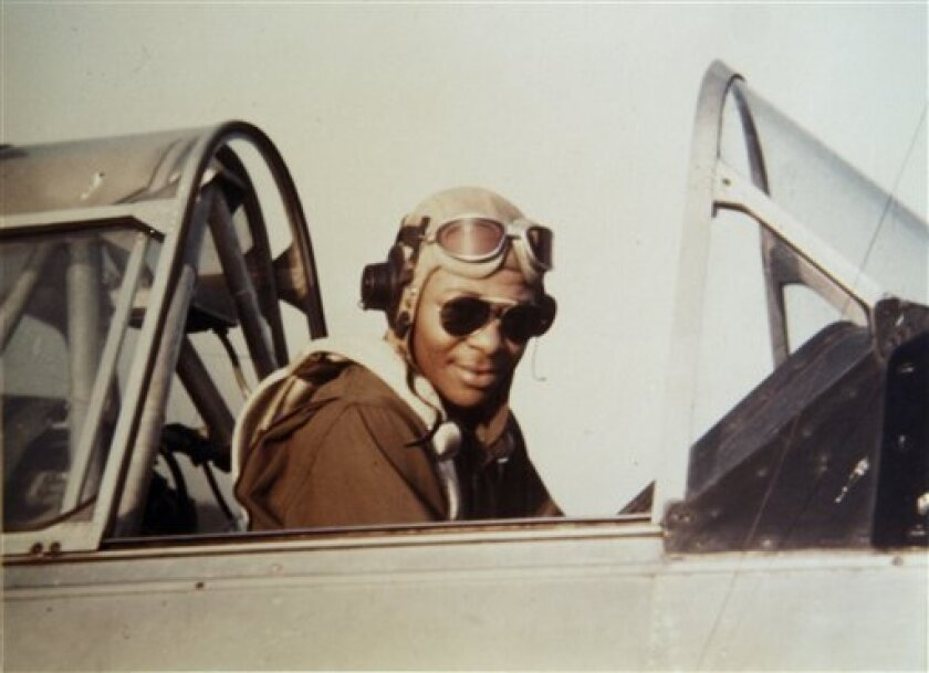 In this handout photo provided by George Hickman, he is seen in the cockpit of an AT6 trainer plane in then-Tuskegee Army Air Field in Tuskegee, Ala. The 84-year-old Hickman is one of the original Tuskegee Airmen, the country's first black military pilots and air maintenance personnel who fought in