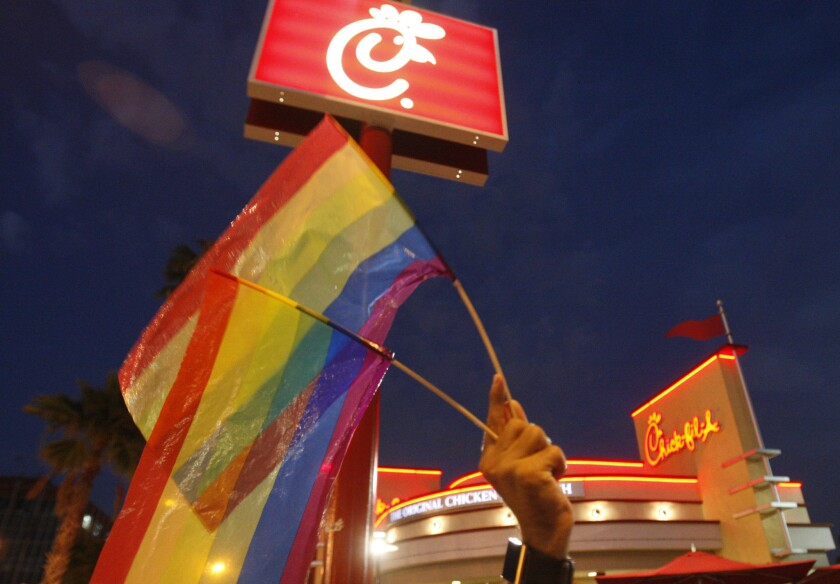 Gay pride flags are waved in front of Chick–fil–A in Hollywood in 2012.