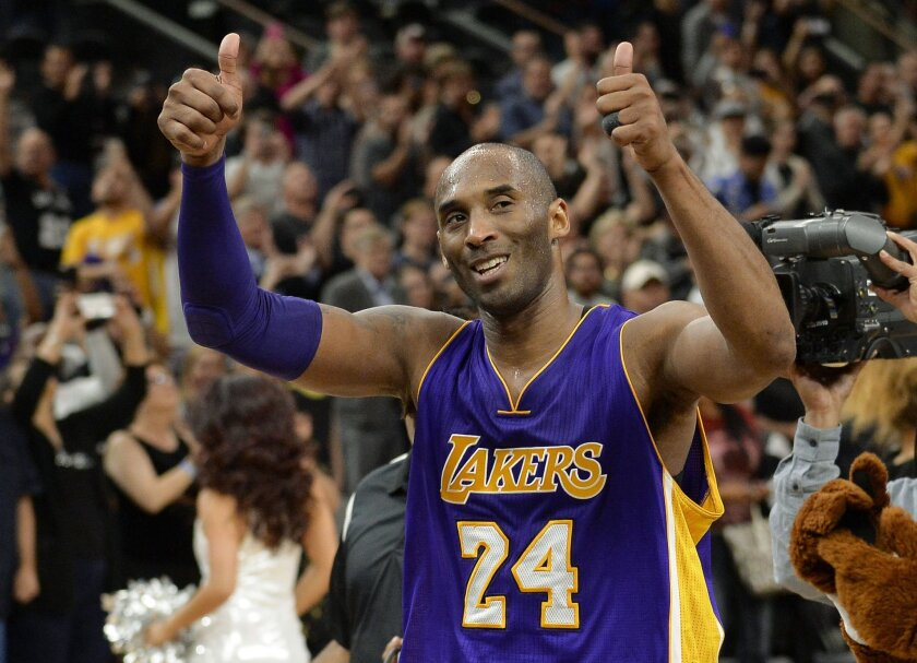 FILE - In this  Saturday, Feb. 6, 2016 file photo, Los Angeles Lakers guard Kobe Bryant gestures to fans as he walks off of the court after an NBA basketball game against the San Antonio Spurs in San Antonio. The final NBA All-Star Game for Bryant and the first to be staged outside the U.S. is in T