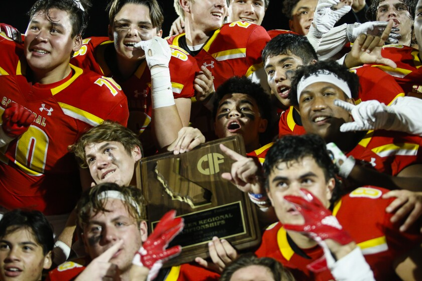 Cathedral Catholic players savor their triumph over Harbor City Narbonne for the 2018 SoCal Regional Division 1-AA title. The Dons went 12-2 last season.