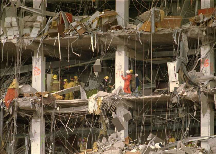 Investigators examine the wreckage of the Alfred P. Murrah Federal Building in 1995