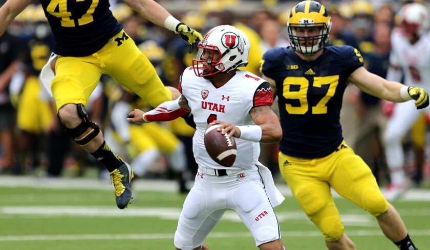 Utah quarterback Kendal Thompson tries to evade the rush of Michigan's defense during their game last weekend.