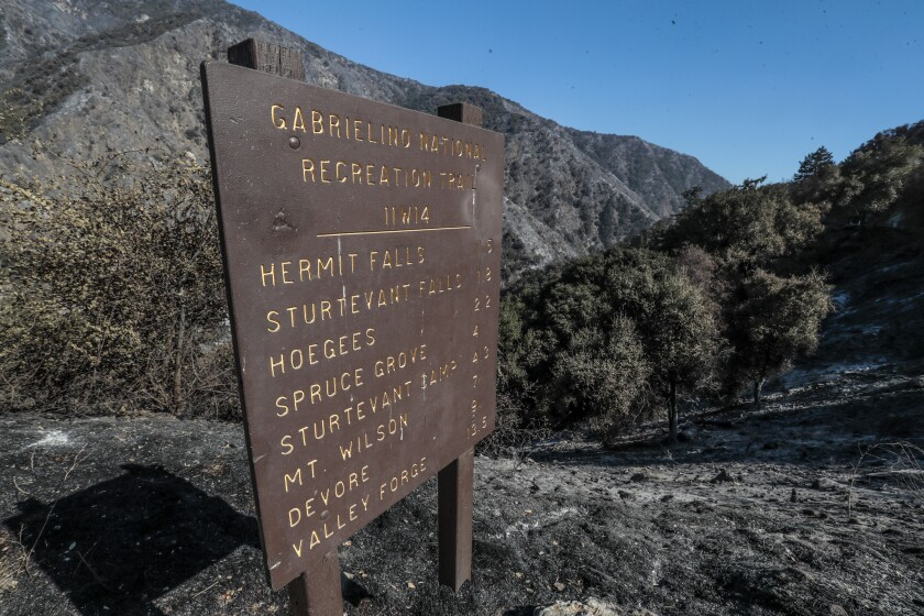 A fire-damaged sign stands above the Gabrielino National Recreation Trail at Chantry Flat.