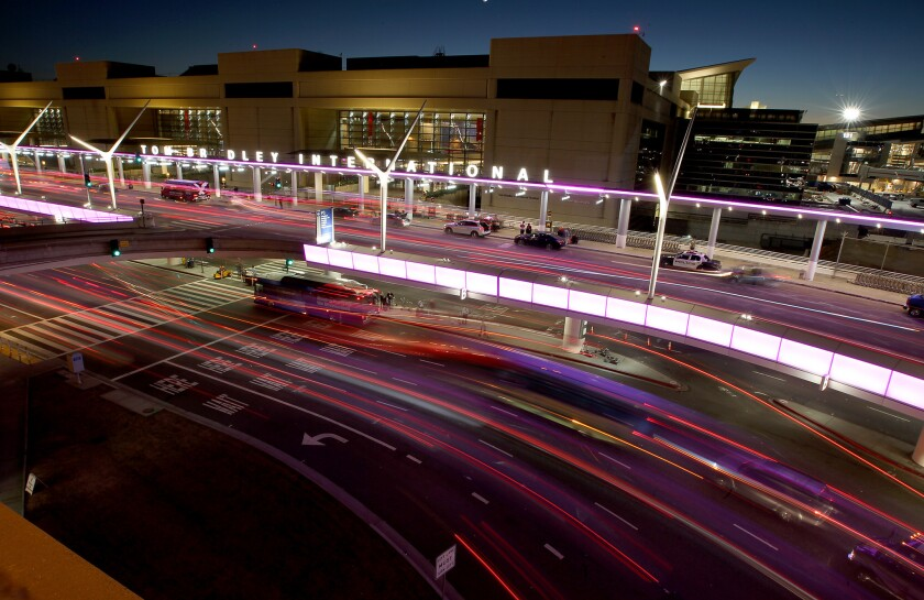 Traffic flows through the central terminal at Los Angeles International Airport, where Lyft drivrs will be allowed to pick up passenger starting at 8 a.m. Wednesday.
