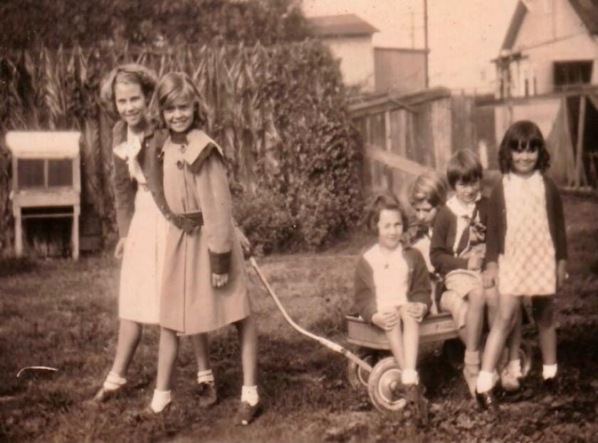 Girls have fun in the schoolyard of Warren-Walker School in the 1930s.
