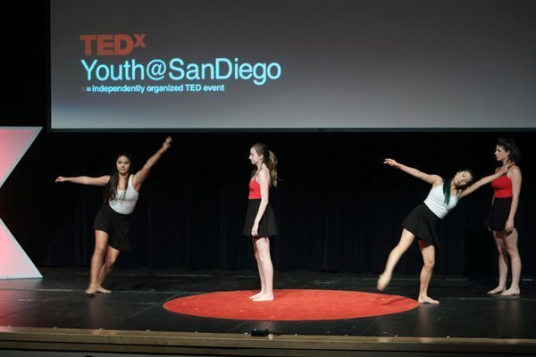Students perform a dance to open the event