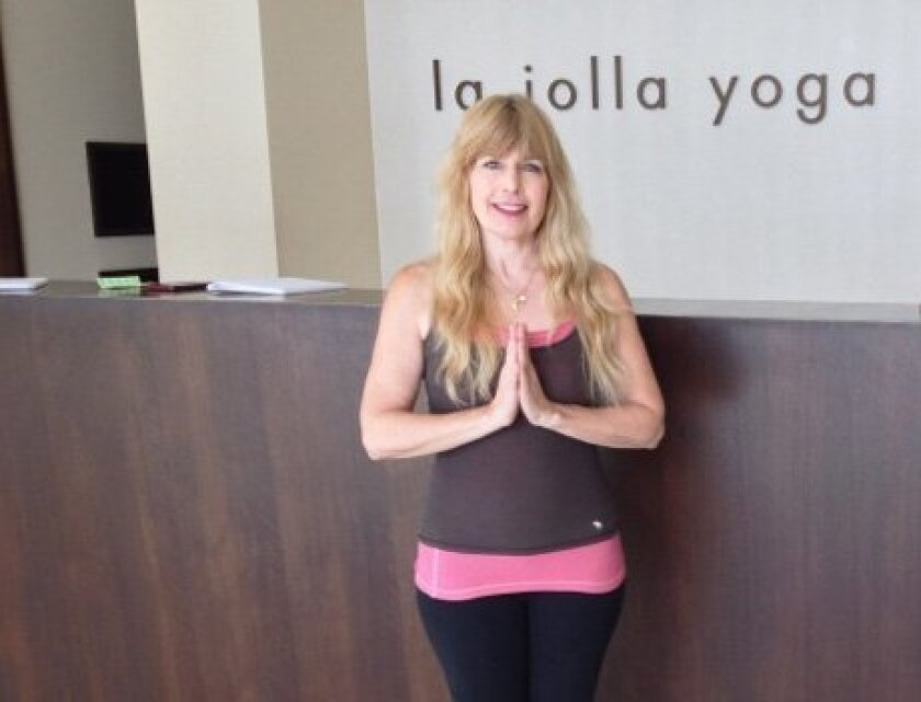 Ellyn Quiggle plans to open La Jolla Yoga at 7743 Fay Ave. Quiggle said practicing yoga helped relieve stress in her life that triggered debilitating symptoms of Crohn's disease.