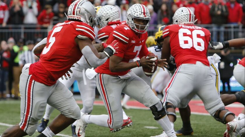 Ohio State quarterback Dwayne Haskins plays against Michigan during a game on Nov. 24, 2018 in Columbus, Ohio.