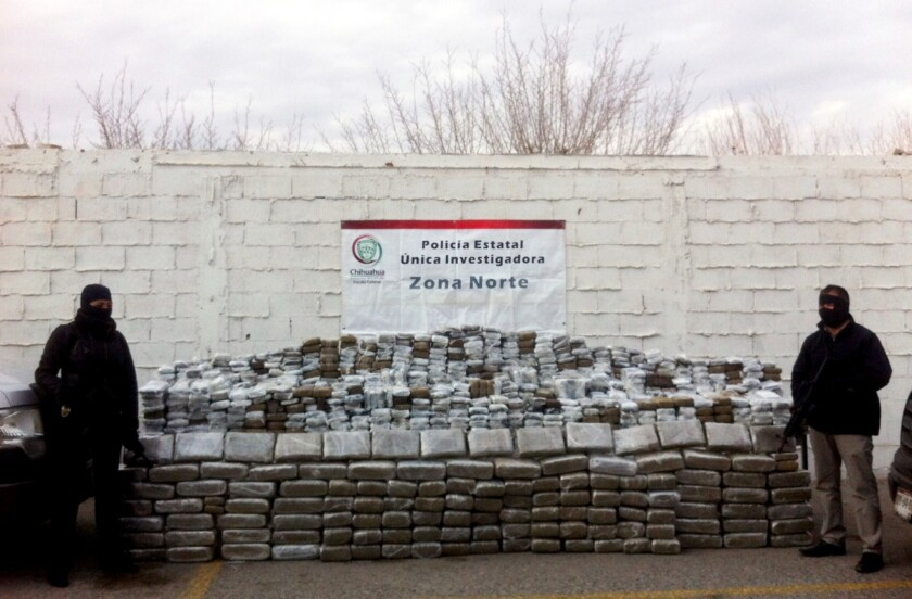 Mexican police officers stand guard next to 2 tons of seized marijuana in Ciudad Juarez, in Chihuahua state.