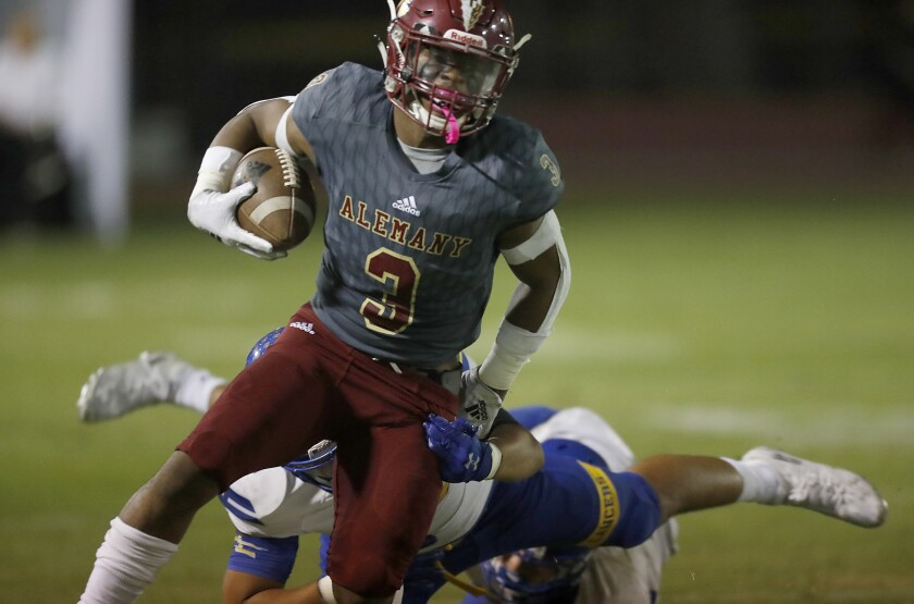 Alemany running back Floyd Chalk sheds an Bishop Amat defender during Friday's game.