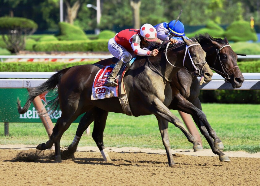 Midnight Bisou (outside) edges past Elate to win the Personal Ensign Stakes on Saturday at Saratoga.