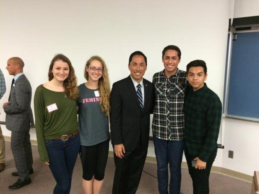 San Diego City Councilmember Todd Gloria (center) champions the Climate Action Plan at UCSD and meets with students following his presentation.