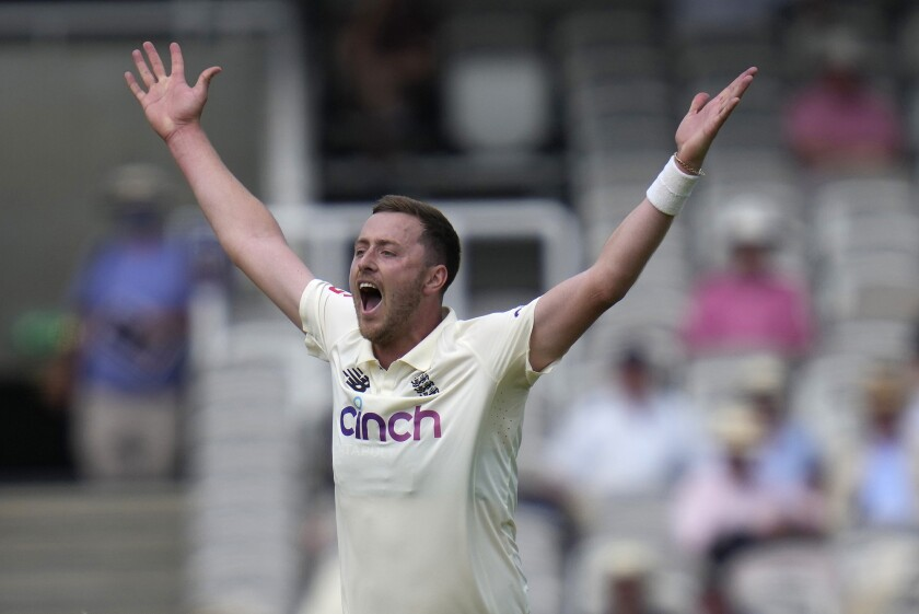 FILE - In this Wednesday, June 2, 2021 file photo, England's Ollie Robinson appeals after bowling during the first day of the Test match between England and New Zealand at Lord's cricket ground in London. Robinson has received an eight-match ban for discriminatory tweets but can return to playing cricket immediately after a portion of the ban was suspended for two years. The England and Wales Cricket Board announced the ban after an investigation into the racist and sexist tweets posted between 2012-14 when Robinson was between the ages of 18 and 20. (AP Photo/Kirsty Wigglesworth, File)