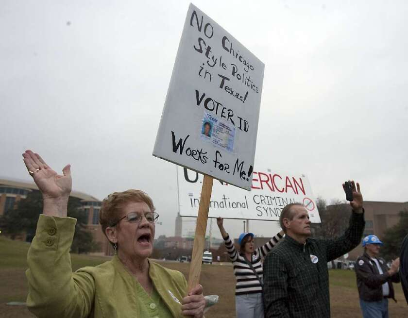 A supporter of voter ID laws protests in Austin, Texas, in 2011.