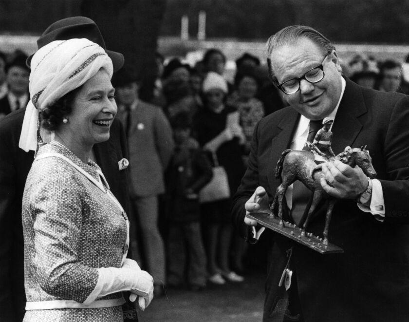 Nelson Bunker Hunt, receiving a winners trophy from Queen Elizabeth II in 1974.