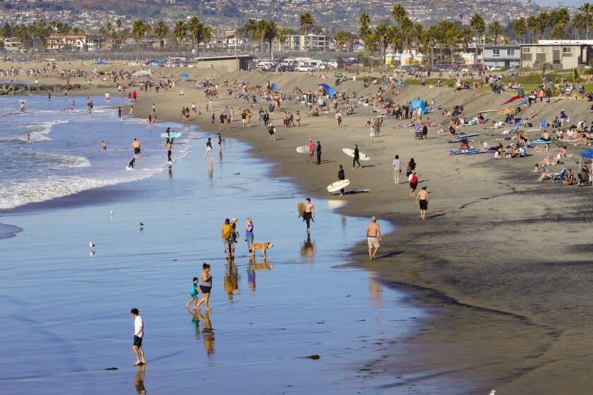 Temperatures rose into the mid-70s Saturday at San Diego County beaches, including at Ocean Beach.
