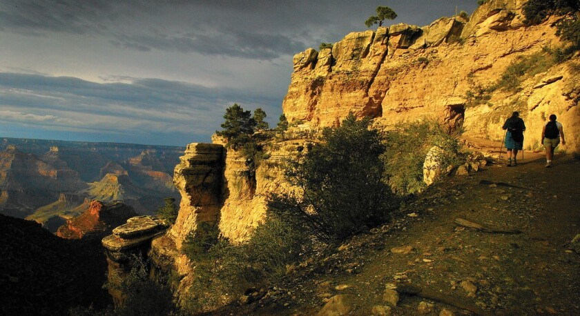 Hikers traverse the Bright Angel Trail at the Grand Canyon.