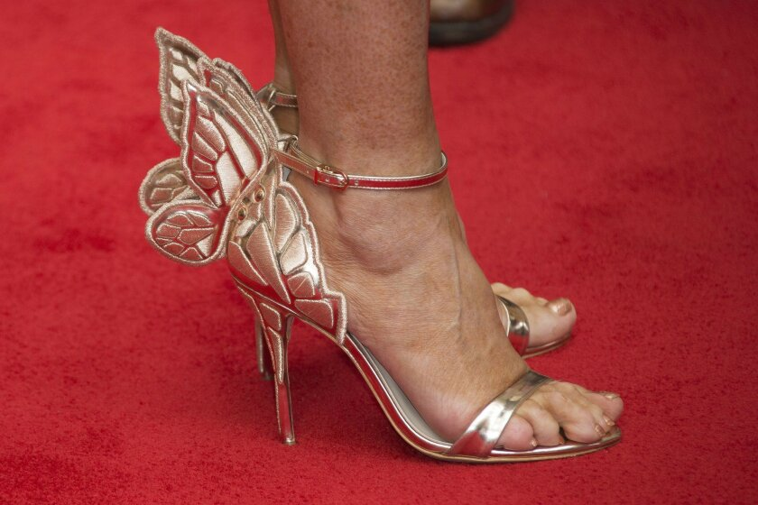 The winged shoes of writer J.K. Rowling, upon arrival at gala performance of Harry Potter and the Cursed Child, at the Palace Theatre in central London, Saturday, July 30, 2016. Based on an original new story by J.K. Rowling, John Tiffany and Jack Thorne, it is the eighth story in the Harry Potter
