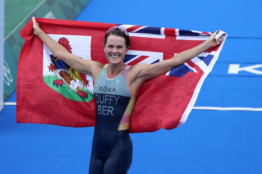 Gold medalist Flora Duffy of Bermuda celebrates after winning the women's individual triathlon competition at the 2020 Summer Olympics, Tuesday, July 27, 2021, in Tokyo, Japan. (AP Photo/David Goldman)