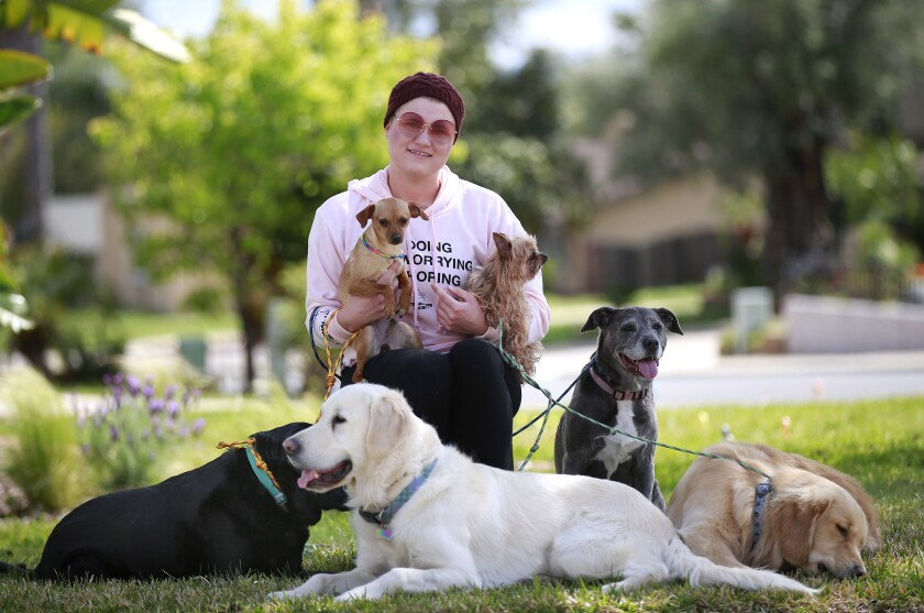 Samantha Benner with dogs, shown here in Escondido on April 4, 2019