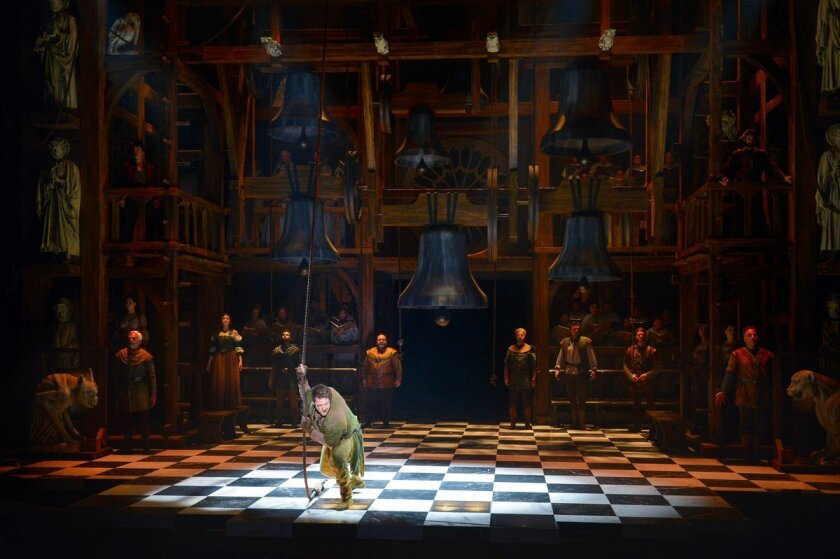 Michael Arden (center) as Quasimodo and the cast of La Jolla Playhouse's U.S. premiere production of 'The Hunchback of Notre Dame.'