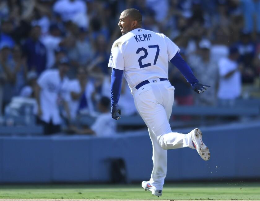 Matt Kemp #27 of the Los Angeles Dodgers runs toward third base after a walkoff double against Brad Boxberger #31 of the Arizona Diamondbacks for a 3-2 win at Dodger Stadium on September 2, 2018 in Los Angeles, California.