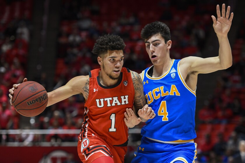 Utah forward Timmy Allen tries to drive past UCLA guard Jaime Jaquez Jr. during the second half of a game Feb. 20 at Jon M. Hunstman Center.